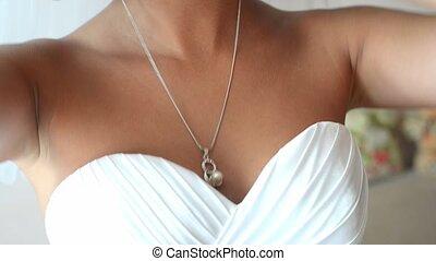 wedding background. beads on silk spinning