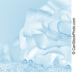 Blue and white tinted flower and pearls soft fade background.