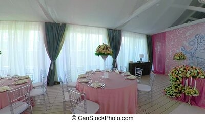 Wedding banquet hall - restaurant with banquet tables in a...
