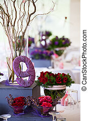 Wedding banquet table with decor and flowers