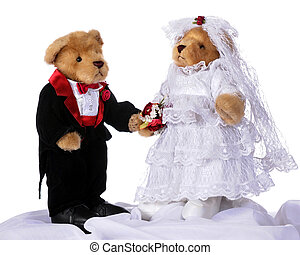 Stuffed bride and groom bears standing together as if at the church altar. Isolated on white.