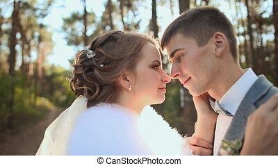 Wedding. Beautiful couple kissing in the sun.