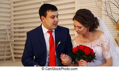 wedding beautiful young  couple sitting on the bed