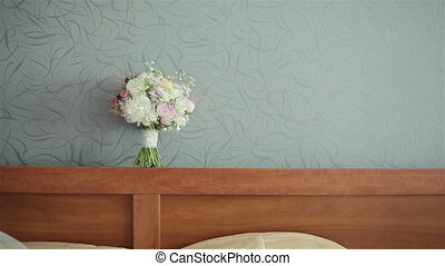 Wedding bouquet above the bed - Wedding bouquet on the gray...