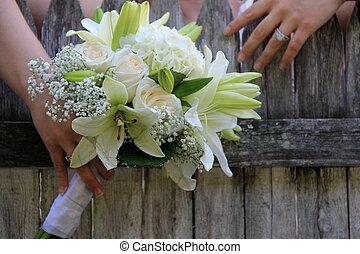 Wedding bouquet and bride's hands