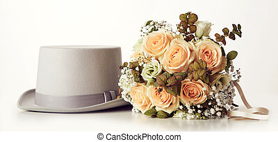 Wedding bouquet and brooms hat