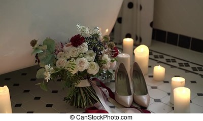 Wedding bouquet and shoes in bathroom