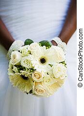 Wedding bouquet - Black woman holding a wedding bouquet