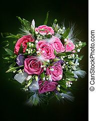 Wedding bouquet from roses on a green background
