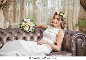 Wedding bouquet hotel room sofa