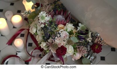 Wedding bouquet in bathroom with candles