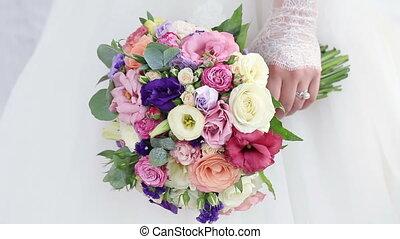 Wedding bouquet in hands bride