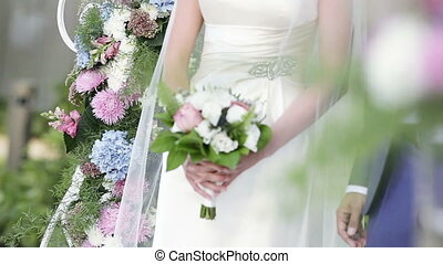 Wedding bouquet in hands of bride