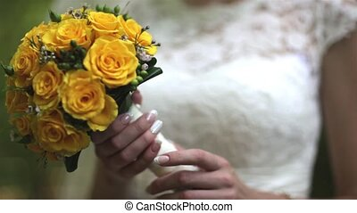 Wedding bouquet in hands