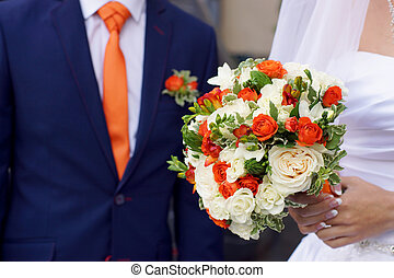 Wedding bouquet in hands of the bride, the combination of colors