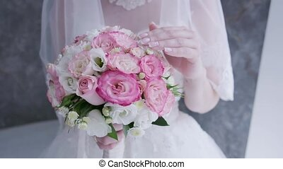 Wedding bouquet in the hands of a beautiful bride,bride holding big wedding bouquet on wedding ceremony,wedding bouquet in bride's hands