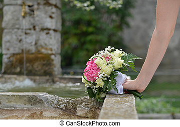 wedding bouquet of flowers in hand the bride