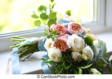 Wedding bouquet of flowers on the windowsill