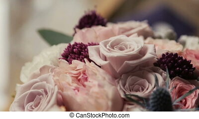 Wedding bouquet of pink and purple roses close up