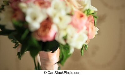 Wedding bouquet of pink roses on the table.