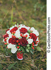 Wedding bouquet of Red and white roses.