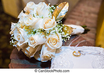 Wedding bouquet of roses with two rings