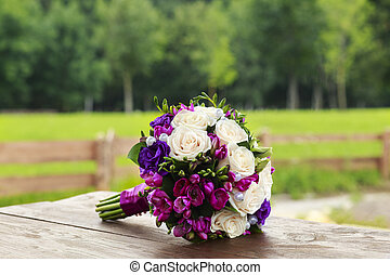 Wedding bouquet of white and blue roses
