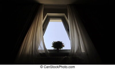 Wedding bouquet of white, pink and red flowers on the window. Bride's morning. Bouquet near the window.