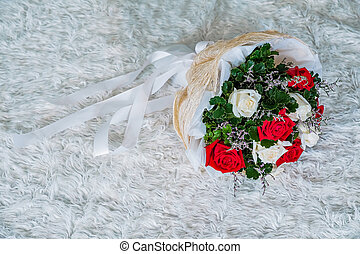 Wedding bouquet of white roses red laying