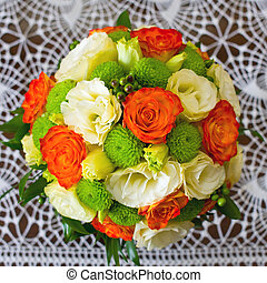Wedding bouquet of yellow and white and orange roses
