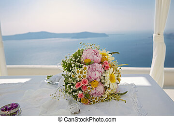 Wedding bouquet on a background of the sea
