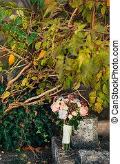 Wedding bouquet on a stone background