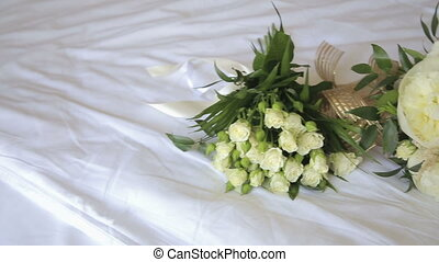 Wedding bouquet on a white tablecloth