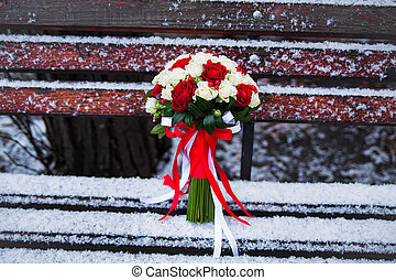 Wedding bouquet on a winter park bench
