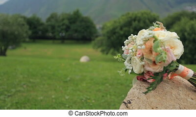 Wedding bouquet on background of picturesque mountains.
