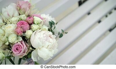 Wedding bouquet on bench