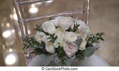 Wedding bouquet on chair steadicam