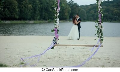 Wedding Bouquet on Seesaw with Married Couple