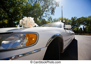 Wedding bouquet on the car - Wedding car decorated with...
