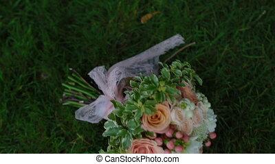 Wedding bouquet on the green grass