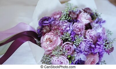 Wedding bouquet on the pillow - Between the pillows is a...