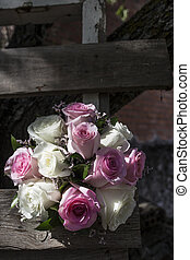 Wedding bouquet on weathered wooden ladder. Spanish country style background
