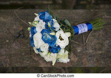 Wedding bouquet on wood background