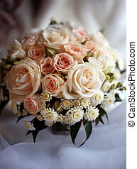 Wedding bouquet from roses and chrysanthemums on a...