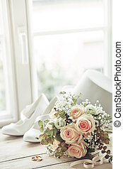Wedding bouquet, rings and white shoes