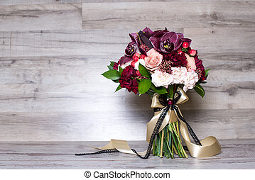 wedding bouquet, the beautiful floral arrangement, on the shabby wooden table