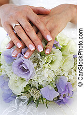 Wedding bouquet - The bride holds a wedding bouquet
