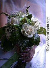 Wedding bouquet - The bride holds a wedding bouquet