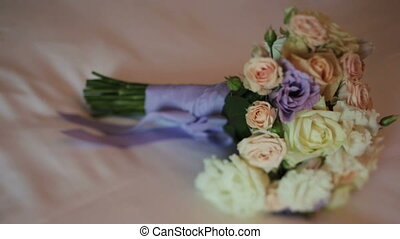 Wedding bouquet with purple ribbons close up