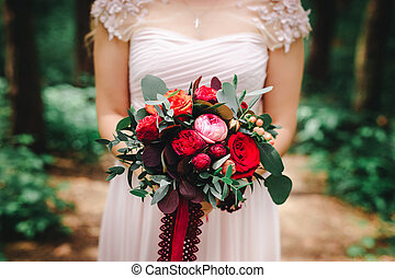wedding bouquet with red flowers